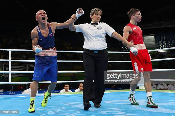 Vladimir Nikitin of Russia celebrates his victory over Michael John Conlan of Ireland in the boxing Men's Bantam Quarterfinal 1 on Day 11 of the Rio...