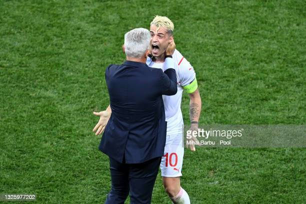 Vladimir Petkovic, Head Coach of Switzerland celebrates with Granit Xhaka of Switzerland after victory in the penalty shoot out in the UEFA Euro 2020...