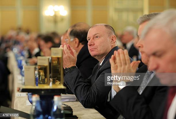 Vladimir Potanin, billionaire and owner of OAO GMK Norilsk Nickel, center, applauds whilst sitting with other Russian billionaires at a meeting of...