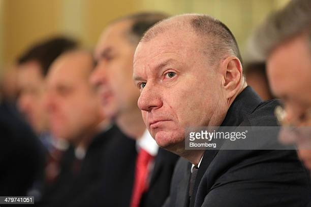 Vladimir Potanin, billionaire and owner of OAO GMK Norilsk Nickel, pauses while sitting with other Russian billionaires at a meeting of the Russian...