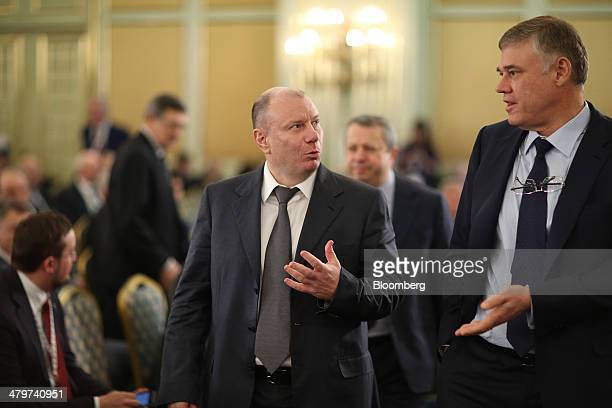 Vladimir Potanin, billionaire and owner of OAO GMK Norilsk Nickel, center, speaks to a fellow attendee at a meeting of the Russian Union of...