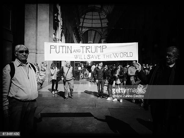 Image has been converted to black and white Vladimir Putin and Donald Trump supporters are seen on October 7 2016 in Milan Italy