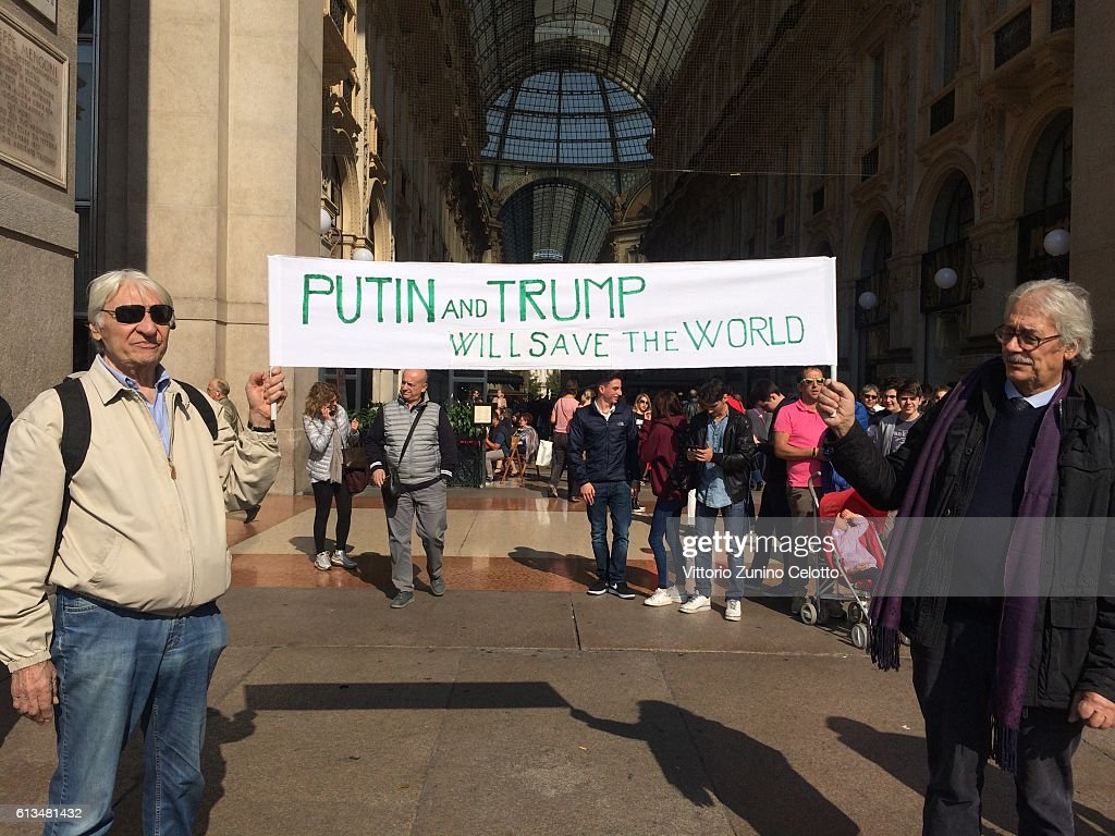Vladimir Putin and Donald Trump supporters are seen on October 7, 2016 in Milan, Italy.