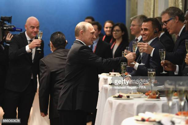 Vladimir Putin President of Russia meets Fabio Cannavaro and Laurent Blanc prior to the Final Draw for the 2018 FIFA World Cup Russia at the State...