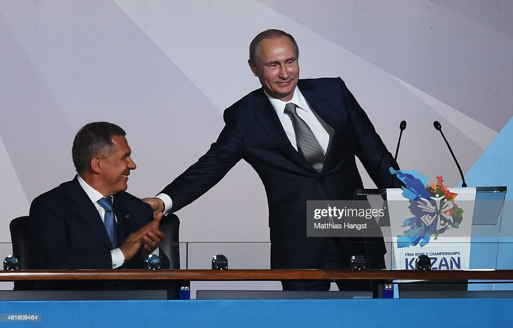 Vladimir Putin (R), President of Russia smiles with Rustam Minnikhanov, Acting President of the Republic of Tatarstan during the Opening Ceremony of the 16th FINA World Championships at TatNeft Arena on July 24, 2015 in Kazan, Russia.