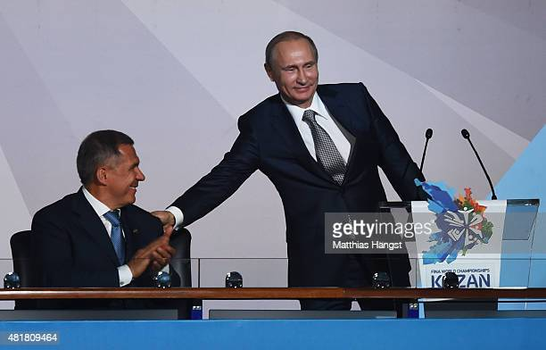 Vladimir Putin President of Russia smiles with Rustam Minnikhanov Acting President of the Republic of Tatarstan during the Opening Ceremony of the...
