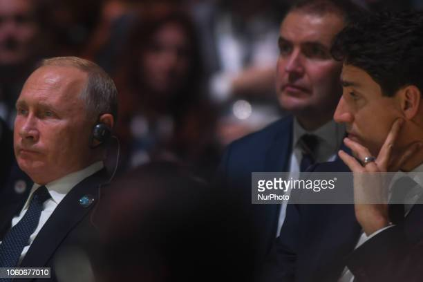 Vladimir Putin Russian President and Justin Trudeau Prime Minister of Canada listen Angela Merkel's speech at the opening session of the Paris Peace...