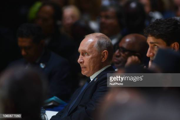 Vladimir Putin Russian President listen Angela Merkel's speech at the opening session of the Paris Peace Forum an event that is a part of the...