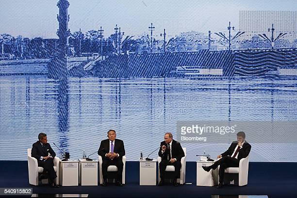 Vladimir Putin Russia's president center right speaks while Matteo Renzi Italy's prime minister right Fareed Zakaria television anchor at CNN left...