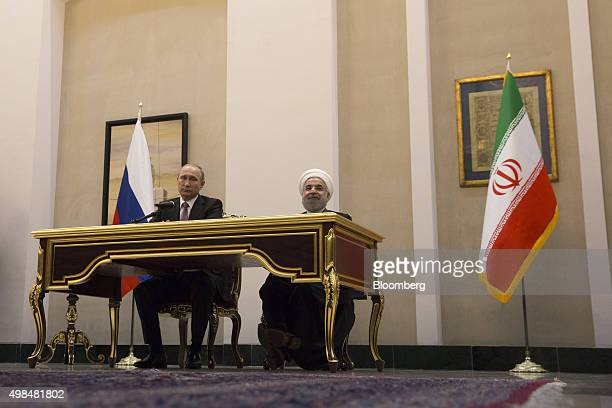 Vladimir Putin Russia's president left and Hassan Rouhani Iran's president listen during a news conference at the Gas Exporting Countries Forum...
