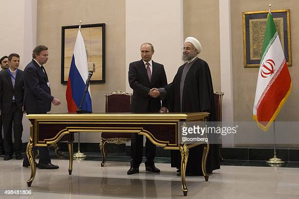 Vladimir Putin Russia's president left and Hassan Rouhani Iran's president shake hands after a news conference at the Gas Exporting Countries Forum...
