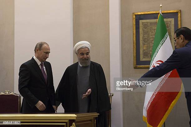 Vladimir Putin Russia's president left and Hassan Rouhani Iran's president stand after a news conference at the Gas Exporting Countries Forum summit...