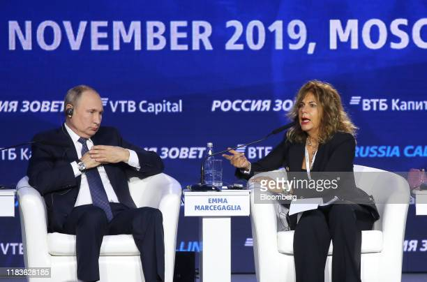 Vladimir Putin, Russia's president, left, listens as Emma Marcegaglia, chairman of Eni SpA, speaks during a panel session at the annual VTB Capital...