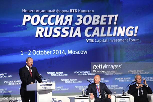 Vladimir Putin Russia's president left speaks as Anton Siluanov Russia's finance minister center and Marco Tronchetti Provera chairman of Pirelli SpA...