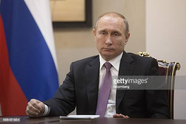 Vladimir Putin Russia's president listens during a news conference alongside Hassan Rouhani Iran's president not pictured at the Gas Exporting...