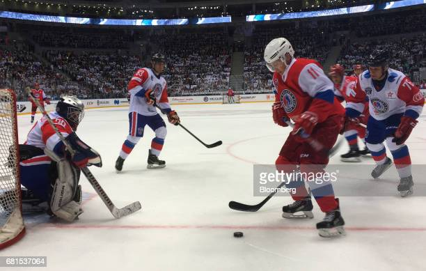 Vladimir Putin Russia's president right plays a gala ice hockey match in the night hockey league in Sochi Russia on Wednesday May 10 2017 The...
