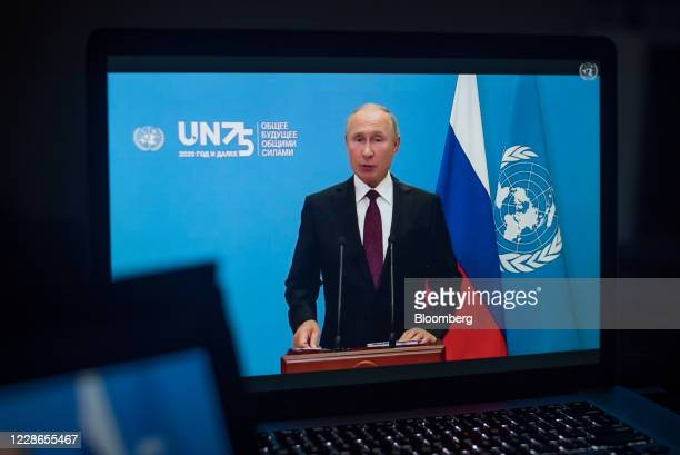 Vladimir Putin Russia's president speaks during the United Nations General Assembly seen on a laptop computer in Hastings on the Hudson New York US...