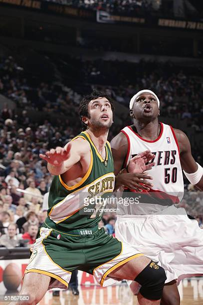 Vladimir Radmanovic of the Seattle SuperSonics guards Zach Randolph of the Portland Trail Blazers shoots during the game on November 30 2004 at the...
