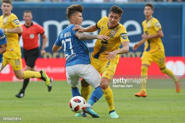 Vladimir Rankovic of Rostock battles for the ball with Malte Amundsen of Braunschweig during the 3Liga match between FC Hansa Rostock and Eintracht...