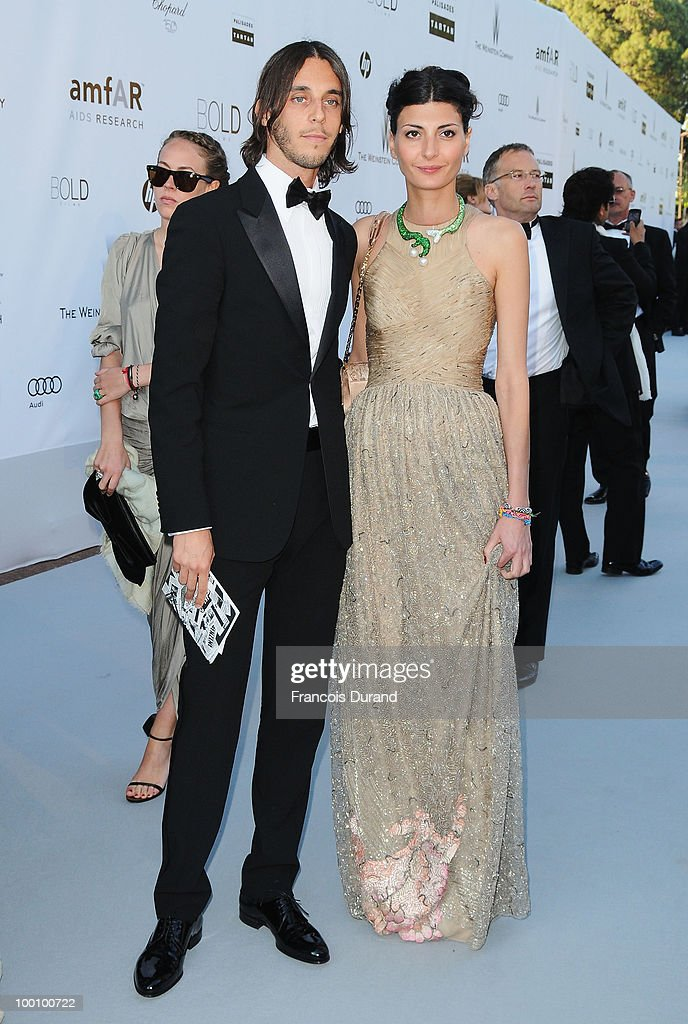 Vladimir Restoin Roitfeld (L) and Giovanna Battaglia arrive at amfAR's Cinema Against AIDS 2010 benefit gala at the Hotel du Cap on May 20, 2010 in Antibes, France.