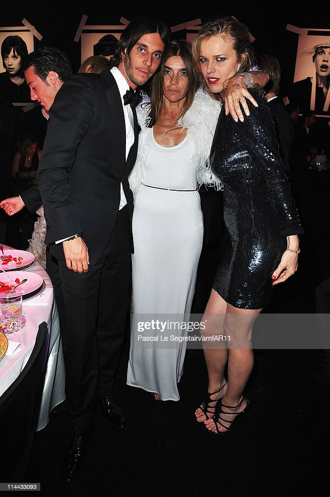 Vladimir Restoin Roitfeld, Carine Roitfeld and Eva Herzigova attend amfAR's Cinema Against AIDS Gala during the 64th Annual Cannes Film Festival at Hotel Du Cap on May 19, 2011 in Antibes, France.