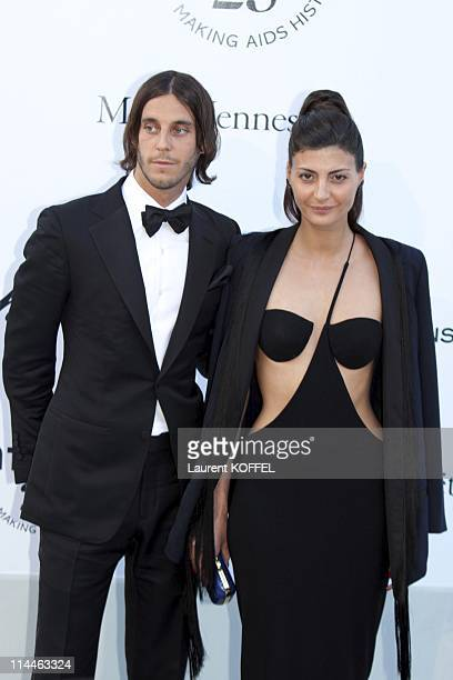 Vladimir Restoin Roitfels and Giovana Battaglia attend amfAR's Cinema Against AIDS Gala during the 64th Annual Cannes Film Festival at Hotel Du Cap...