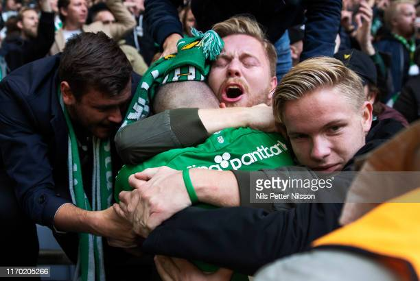 Vladimir Rodic of Hammarby IF celebrates with fans after scoring to 2-0 during the Allsvenskan match between Hammarby IF and AIK at Tele2 Arena on...