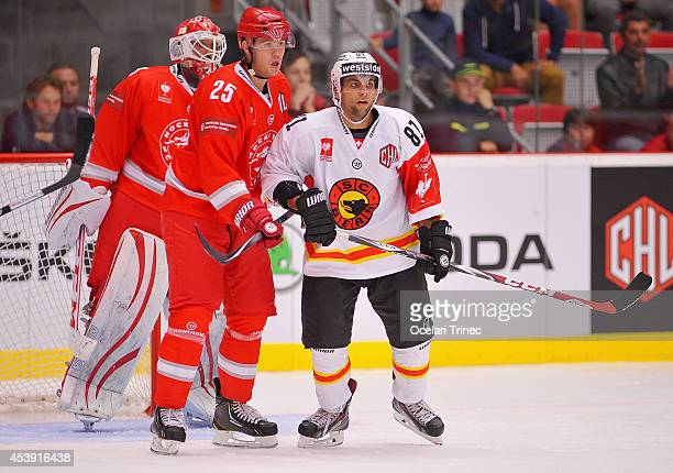 Vladimir Roth of HC Ocelari Trinec and Thomas Rufenacht of SC Bern during the Champions Hockey League group stage game between HC Ocelari Trinec and...
