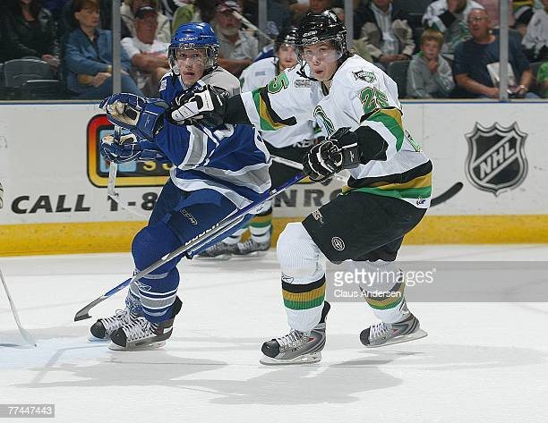 Vladimir Roth of the London Knights holds up Jared Staal of the Sudbury Wolves in a game played on October 5, 2007 at the John Labatt Centre in...