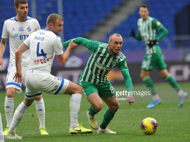 Vladimir Rykov FC Dynamo Moscow and Denis Glushakov FC Akhmat vie for the ball during the Russian Football League match between FC Dynamo Moscow and...