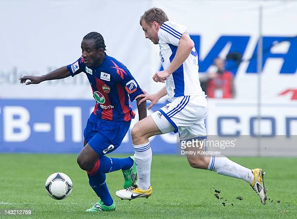 Vladimir Rykov of FC Dynamo Moscow and Seydou Doumbia of PFC CSKA Moscow vie for the ball during the Russian Football League Championship match...