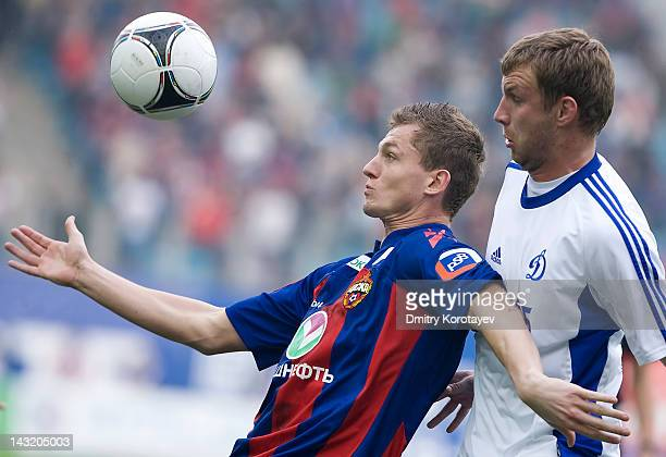 Vladimir Rykov of FC Dynamo Moscow and Tomas Necid of PFC CSKA Moscow vie for the ball during the Russian Football League Championship match between...