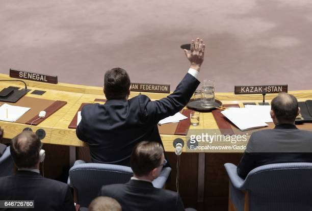 Vladimir Safronkov Russia's deputy ambassador to the UN raising his hand during the Security Council meeting on Syria's use of chemical weapons at...