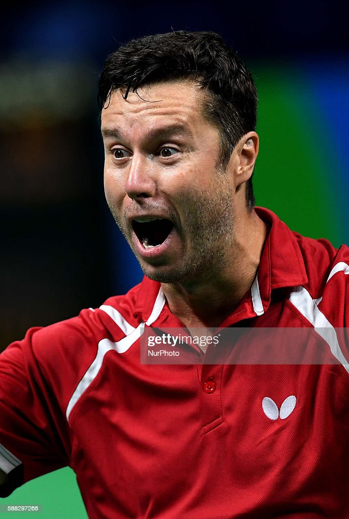 Vladimir Samsonov of Belarus reacts after a men's singles quarterfinal match of table tennis against Dimitrij Ovtcharov of Germany at the 2016 Rio Olympic Games in Rio de Janeiro, Brazil, on Aug. 9, 2016. Vladimir Samsonov won 4-2. / CHINA OUT