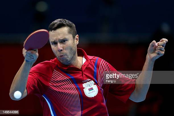 Vladimir Samsonov of Belarus returns the ball during his Men's Singles Table Tennis fourth round match against Zhang Jike of China on Day 3 of the...