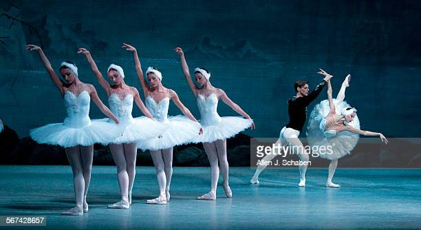 Vladimir Schklyarov is Prince Siegfried and Oxana Skorik is Odette, Queen of Swans, at right, as they perform with dancers in 'Swan Lake' by the...