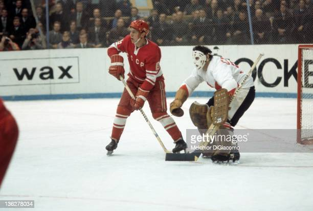 Vladimir Shadrin of the Soviet Union stands in front of goalie Tony Esposito of Canada during the 1972 Summit Series at the Luzhniki Ice Palace in...