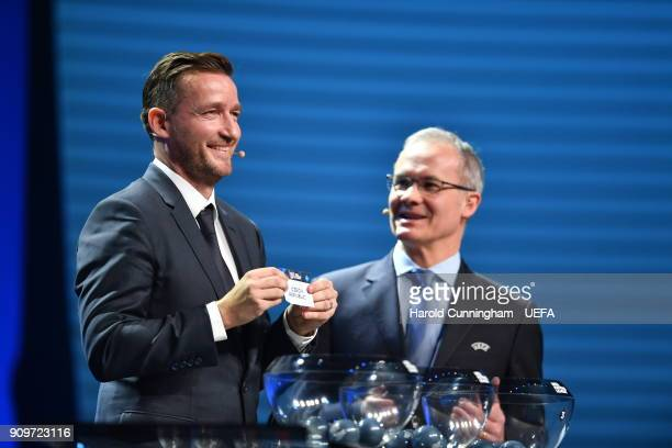 Vladimir Smicer draws out the name of the Czech Republic beside UEFA Deputy General Secretary Giorgio Marchetti during the UEFA Nations League Draw...