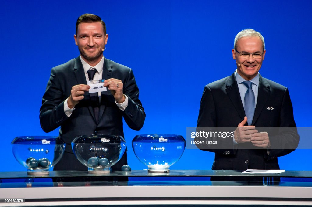 Vladimir Smicer, former Czech Republic football player, (L) shows the slip of Ukraine during the UEFA Nations League Draw 2018 at Swiss Tech Convention Center on January 24, 2018 in Lausanne, Switzerland.