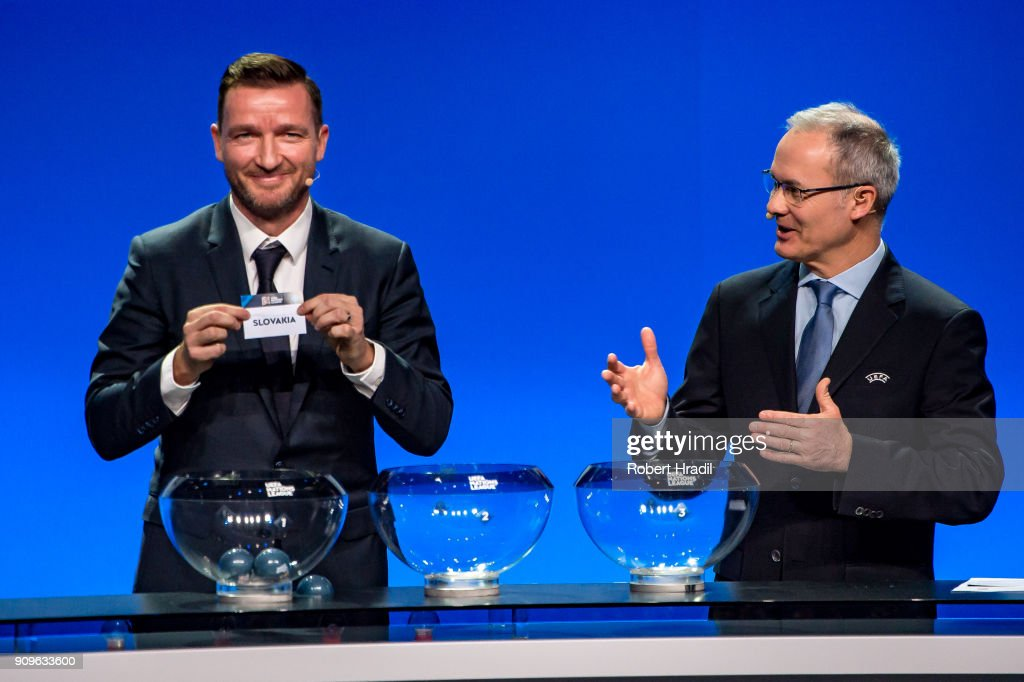Vladimir Smicer, former Czech Republic football player, (L) shows the slip of Slovakia during the UEFA Nations League Draw 2018 at Swiss Tech Convention Center on January 24, 2018 in Lausanne, Switzerland.