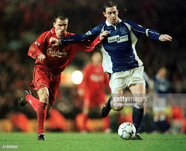 Vladimir Smicer Liverpool's Czech international is tackled by Everton's David Weir during the English Premiership derby match at Liverpool's Anfield...