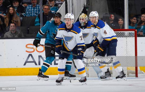 Vladimir Sobotka Jake Allen and Carl Gunnarsson of the St Louis Blues defend the net against Evander Kane of the San Jose Sharks at SAP Center on...