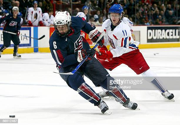Vladimir Sobotka of Team Czech Republic chases after a loose puck along with Erik Johnson of Team USA during their World Jr. Hockey Championship...
