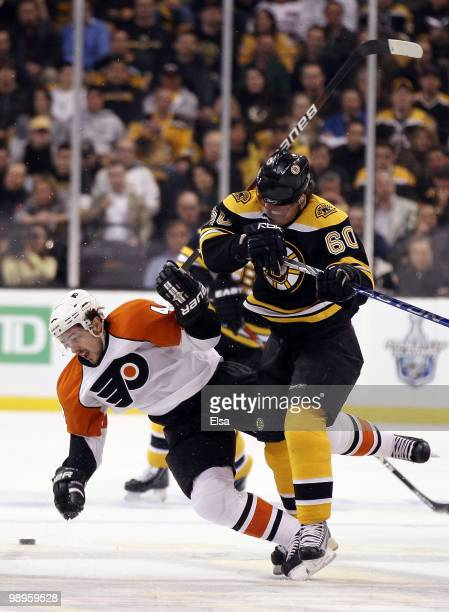 Vladimir Sobotka of the Boston Bruins and Danny Briere of the Philadelphia Flyers collide in Game Five of the Eastern Conference Semifinals during...