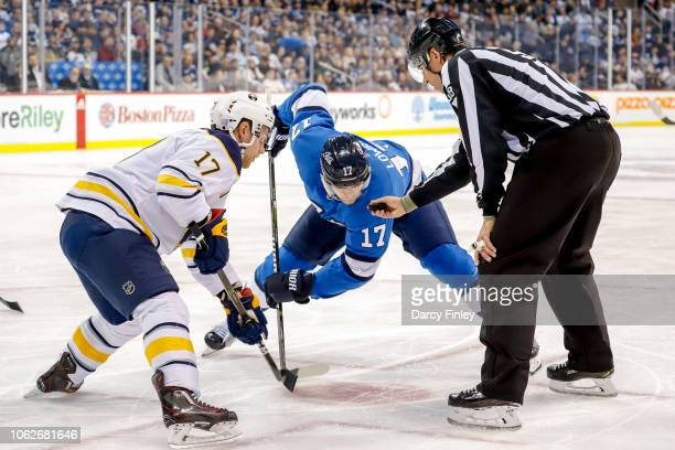 Vladimir Sobotka of the Buffalo Sabres and Adam Lowry of the Winnipeg Jets get set for a second period faceoff at the Bell MTS Place on November 16...