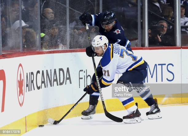 Vladimir Sobotka of the St Louis Blues and Ben Chiarot of the Winnipeg Jets battle for the puck along the boards during third period action at the...