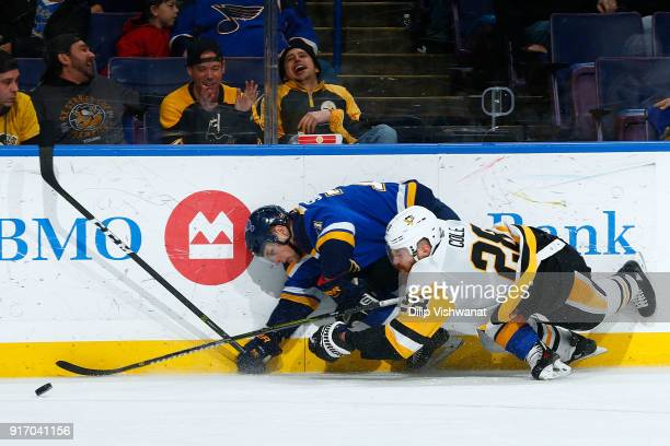 Vladimir Sobotka of the St Louis Blues and Ian Cole of the Pittsburgh Penguins race to the puck at Scottrade Center on February 11 2018 in St Louis...