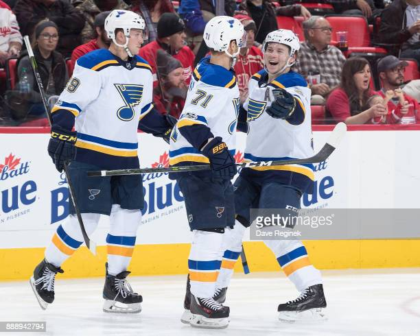 Vladimir Sobotka of the St Louis Blues celebrates his second period goal with teammates Vladimir Tarasenko and Vince Dunn during an NHL game against...