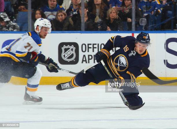 Vladimir Sobotka of the St Louis Blues chases Jake McCabe of the Buffalo Sabres as he clears the puck during the second period of an NHL game on...