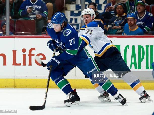 Vladimir Sobotka of the St Louis Blues checks Ben Hutton of the Vancouver Canucks during their NHL game at Rogers Arena November 18 2017 in Vancouver...